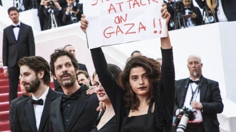 اعتراض به کشتار فلسطینی ها روی فرش قرمز جشنواره کن