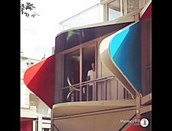 خانه با نمای رقصان در سوئیس با دیوار و بالکن های متحرک