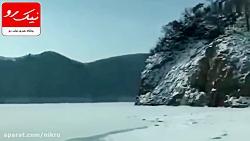 غرق شدن وحشتناک خودروی یک خانواده هنگام حرکت روی رودخانه یخ زده