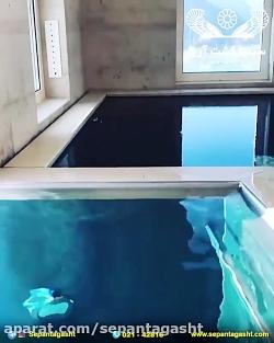 استخر آب گرم احاطه شده ...