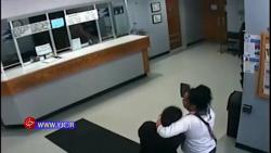 گروگان گیری یک زن با ساطور در اداره پلیس آمریکا