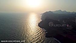 غروب خورشید در آب های نیلگون خلیج فارس، جزیره هرمز