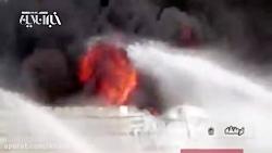 آتش نشانان در حال مهار آتش پتروشیمی بیستون