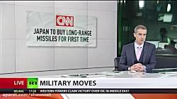Japan aims to buy long-range missiles desp...