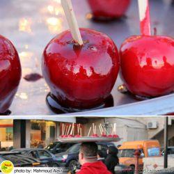 دستفروش کنار ساحل #شیرینی #میوه_ای می فروخت. #سیب را داخل #مربا کرده بود و می گفت خیلی خوشمزه است.