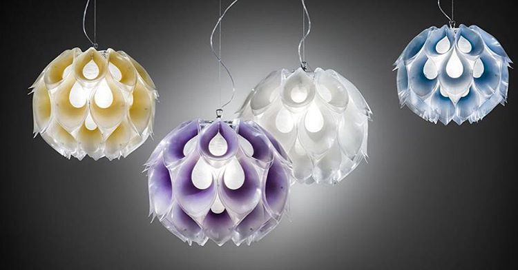 Flora Design by Zanini De Zanine Inspired by the lush plants of the Brazilian jungle, Flora's delicate, subtle tones turn its petals into a fascinating crown of light. The design is structured around a central light source contained in a frosted sphere. Subtle tones turn the petals into a fascinating light ball. www.tiserra.com