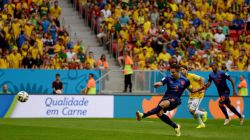 Robin van Persie of the Netherlands scores his team's first goal from the penalty spot