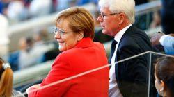 German Chancellor Angela Merkel looks on prior