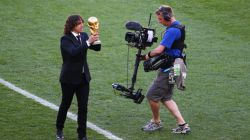 Former Spanish international Carles Puyol holds the World Cup trophy