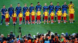 Argentina players line up on the pitch for the National Anthem prior to the 2014 FIFA World Cup Brazil Final