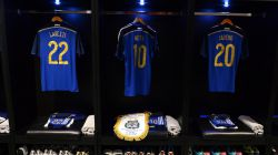 The shirts worn by Ezequiel Lavezzi, Lionel Messi and Sergio Aguero of Argentina and the match pennant displayed in the dressing