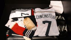 The shirts worn by Bastian Schweinsteiger of Germany are displayed in the dressing room