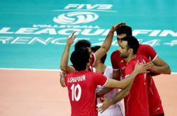 Amir Ghafour with his teammates of Iran celebrate